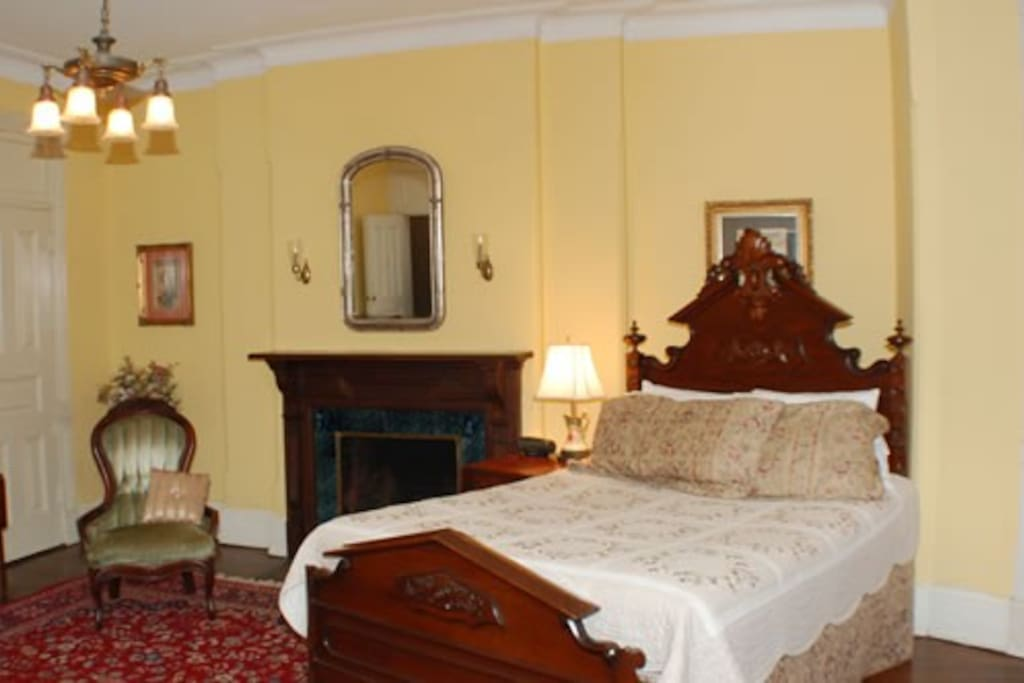 The room features a queen sized carved bed with a twin trundle which comes up to regular bed height, allowing the room to accommodate three guests.