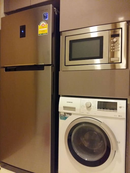 Big fridge, Microwave & All in one Washing & Drying Machine.