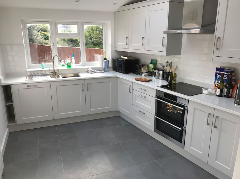 The kitchen can be used by guests and has induction hob, dishwasher and washing machine.