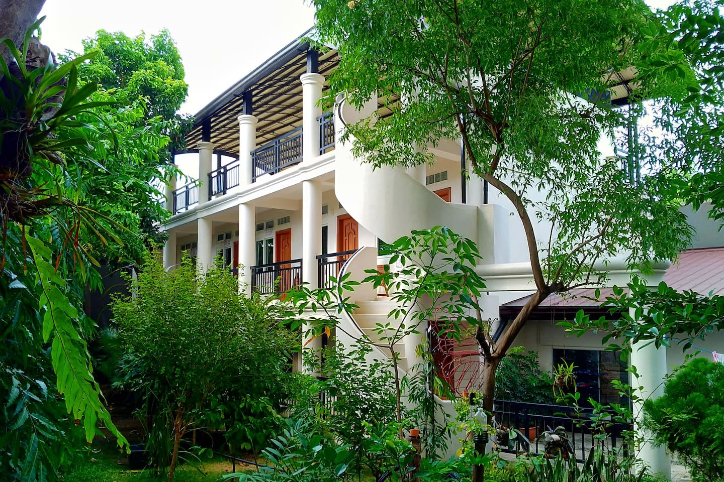Our 3 storey Guest Building with 5 private Hotel-style rooms.