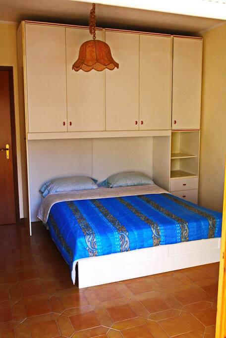 Camera da letto con accesso alla terrazza