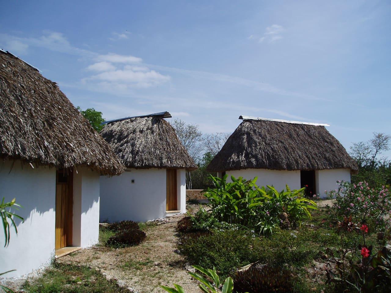 three mayan-style palapas