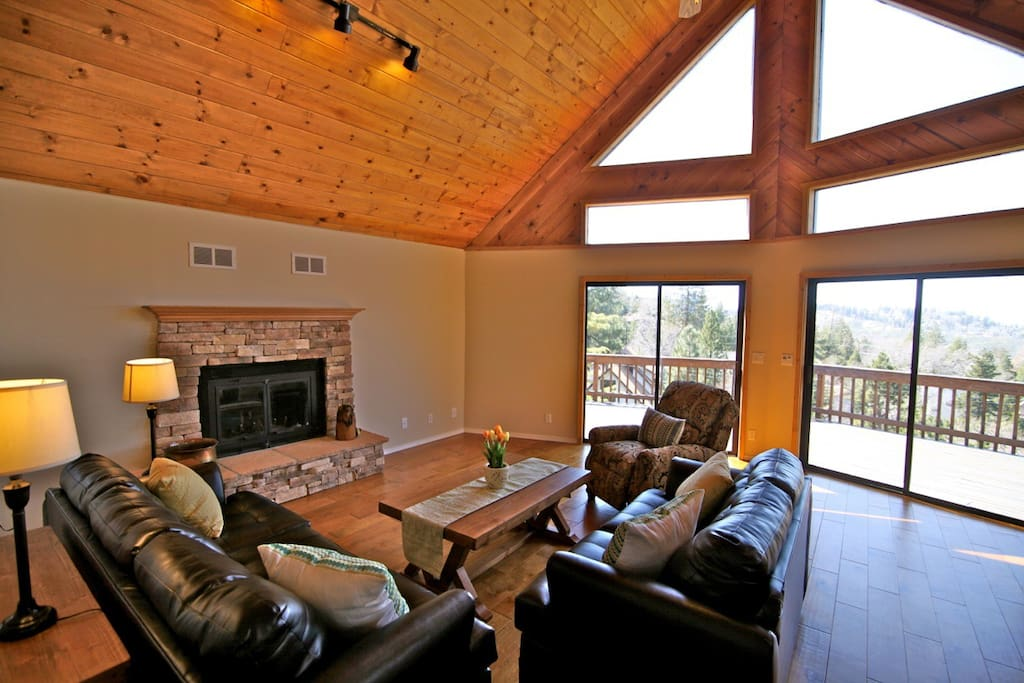 Family room with vaulted ceilings and wall of glass