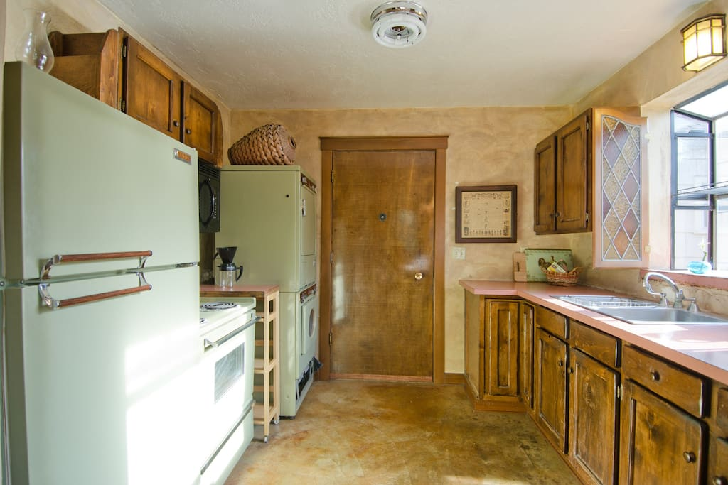 Fully equipped kitchen with a garden view makes cooking a pleasure.