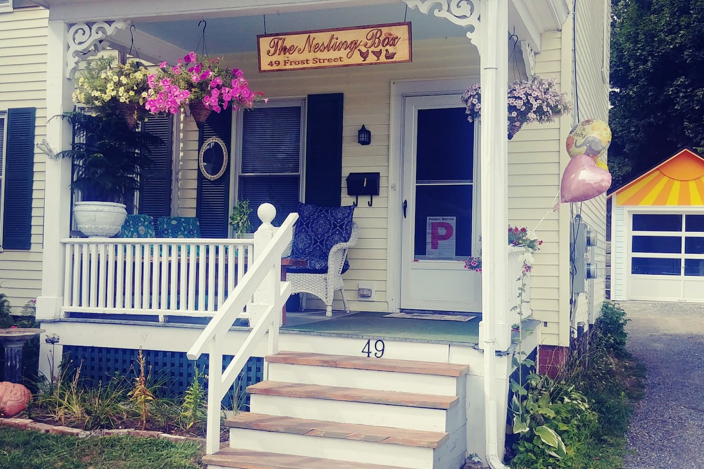 Welcome to The Nesting Box! Located in Downtown Brattleboro, Vermont.  Our sunny porch, driveway and garage.