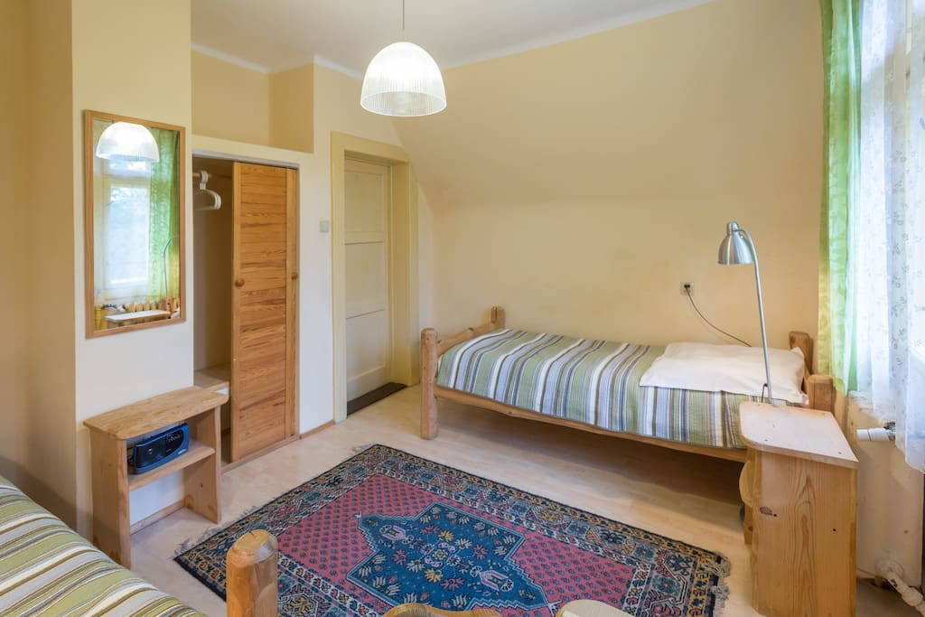 Bedroom with 2 single beds and balcony.