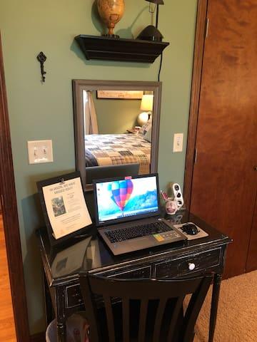 "Desk/vanity table in ""Peace of Oz"" guest room."
