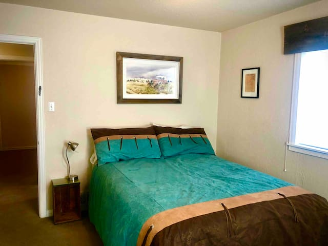 Bedroom has queen bed, (2) built in closets, built-in dresser, bureau, high-end bedding and curated artwork.