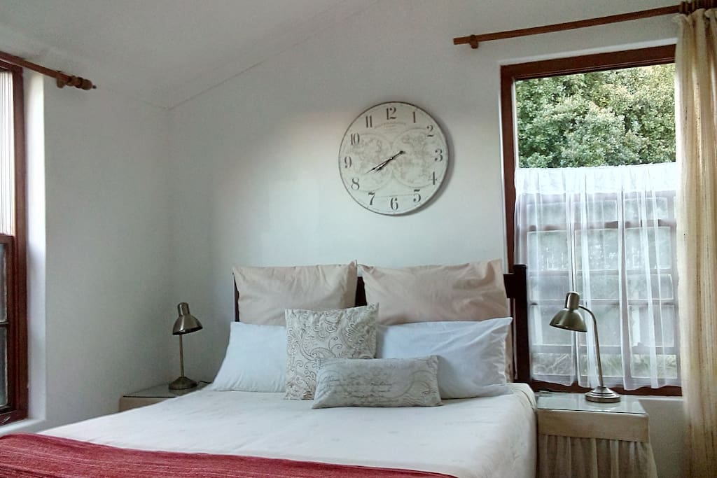 Your bedroom is a bright sunny space with windows on three sides, great views and bathroom on suite.