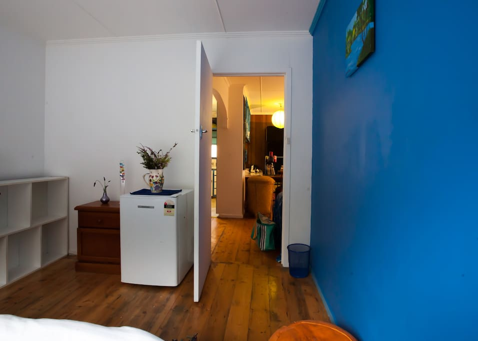 Bar fridge and breakfast amenities in guest bedroom.
