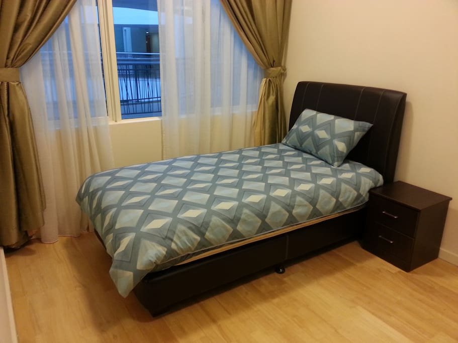 3rd room with single bed & wardrobe