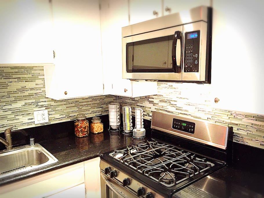 Newly remodeled kitchen, w/microwave, stove, dishwasher, refrigerator