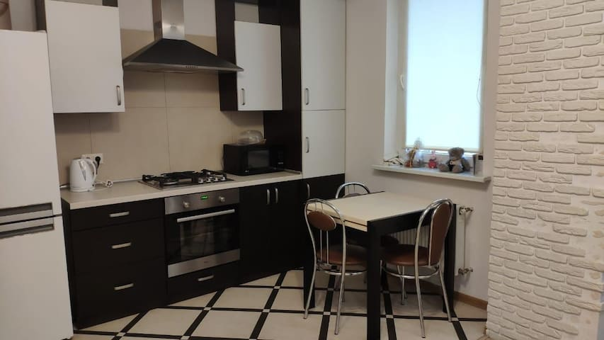 Open plan kitchen, cooking facilities with dining table for 4 plus