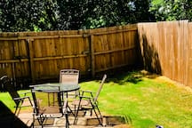 Patio set in your private backyard. There is also a charcoal grill for your use