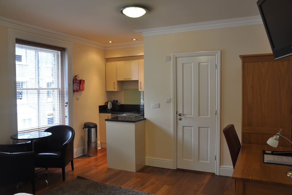 Kitchen and en suite in this one room studio apartment