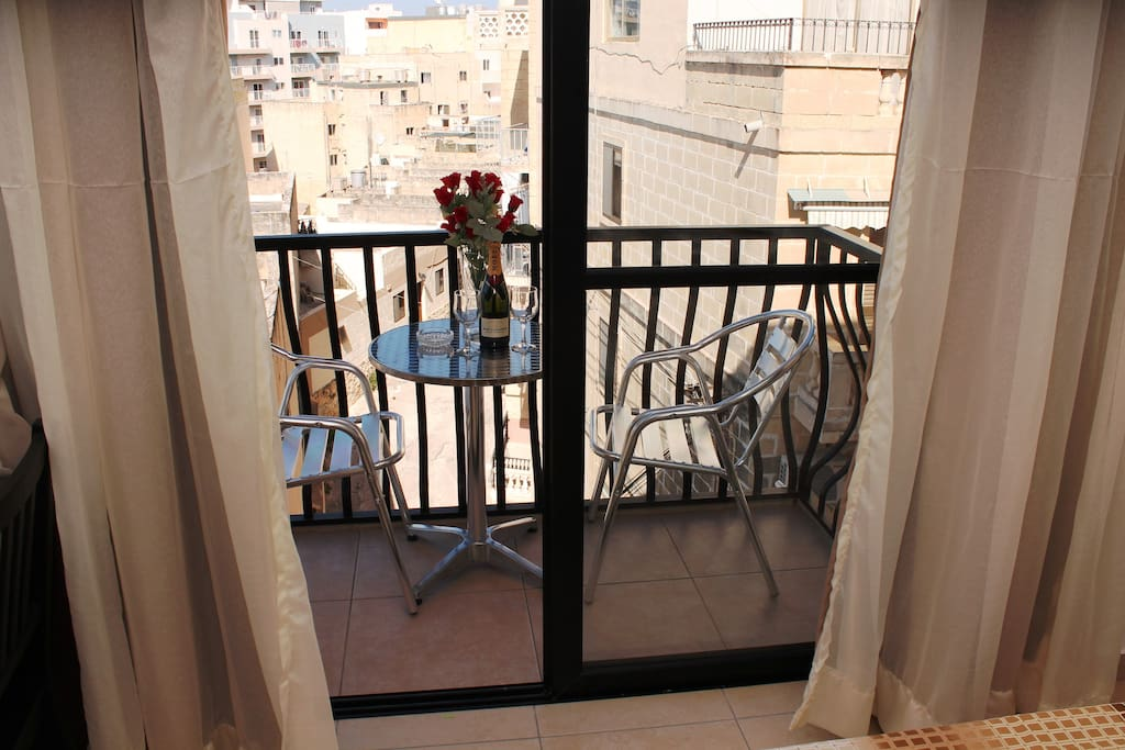 Front balcony with table and chairs