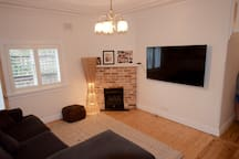 Family TV room with gas fire and large flat screen