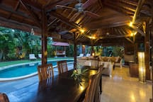 Our external dining room and livng room overlooking the pool and garden