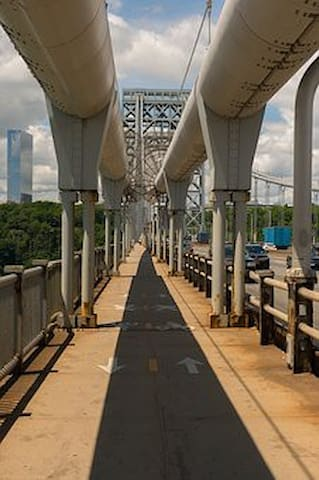 George Washington Bridge, Fort Lee Connects Harlem NYC. Harlem is considered up town. Once in Manhattan several ways to head down town.