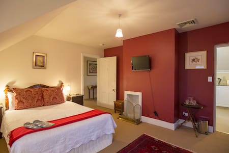 The cosy upstairs Queen room, with ensuite bathroom.  Sleep 3 adults, with one queen bed and one sofa bed.