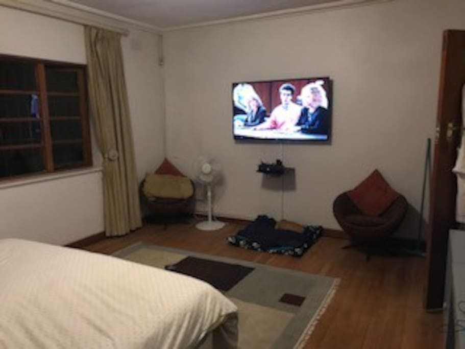 Main bedroom with large TV