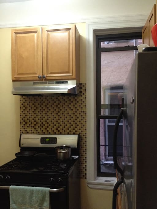 Newly renovated kitchen with pantry and all necessary cooking/eating utensils.