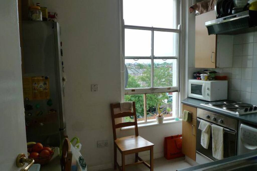 Our kitchen is fully equipped and gets a lot of light with a lovely view of London