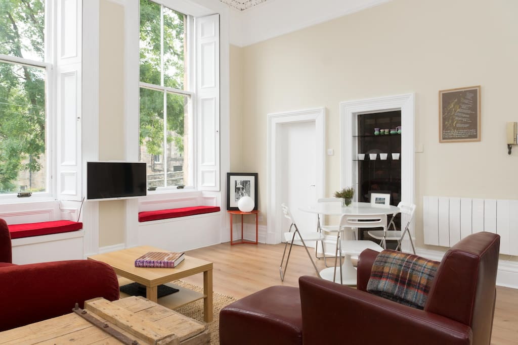 The open-plan space has 4 metre tall ceilings with large traditional sash windows that provide lots of natural light via their south-facing aspect.
