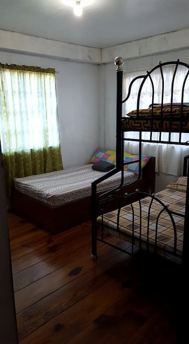 Bedroom has a double sized bed and a double deck bed (54 inch wide lower bed and 36 inch upped bed). Bed sheets, pillows pillow cases and blankets are provided.