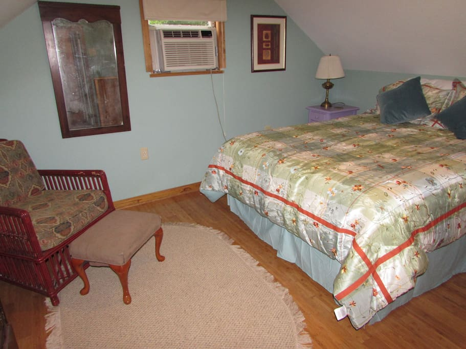 a queen size bed and full bathroom with shower