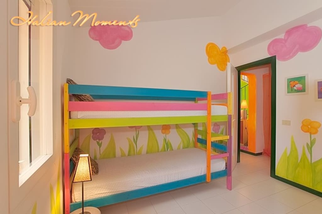 Colorful bedroom with bunkbeds.