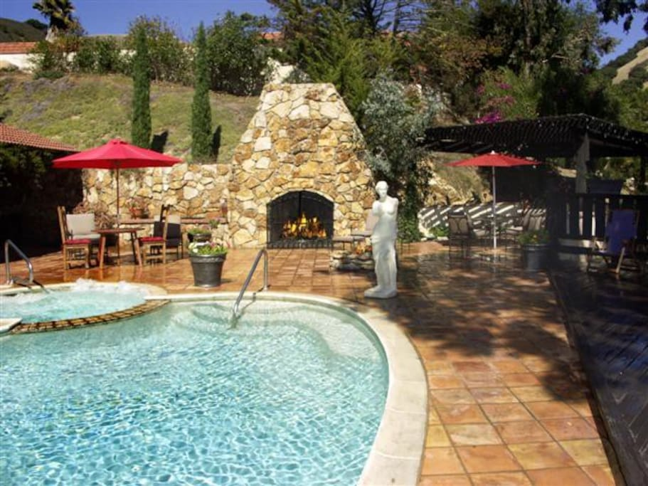 The outdoor pool and stone fireplace