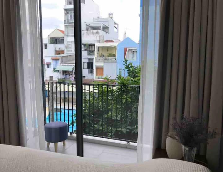 Contemporary pool view studio with balcony