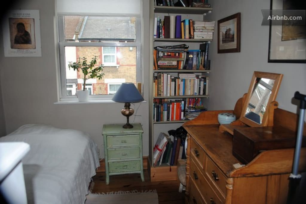Single room with real bed, chest of drawers and hanging on same floor as bathroom