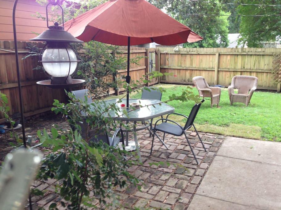 The view outside sunroom windows.  Enjoy an al fresco supper on the patio
