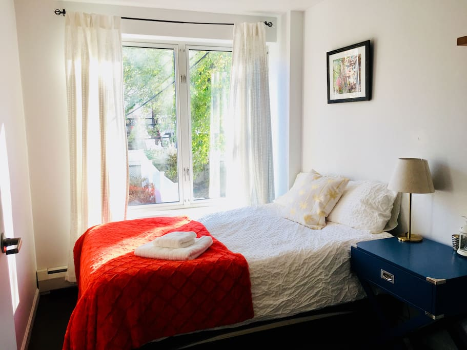 Spacious bedroom with huge double-glazed windows, light all day, even in winter