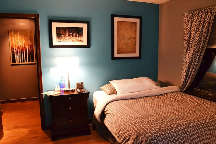 The guest room is newly decorated in Indy decorations/old railroad maps, and the bed is very comfortable! We want your Indy experience to truly be relaxing and enjoyable. The door leads into the hallway upstairs, which to the right is the bathroom.