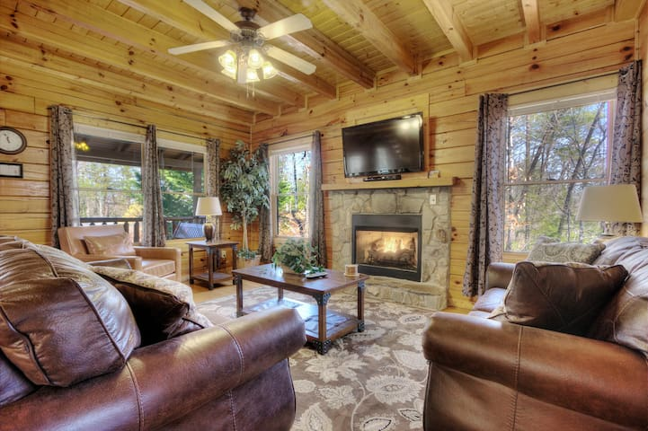 One of the inviting living rooms, boasting a flat screen TV and gas fireplace