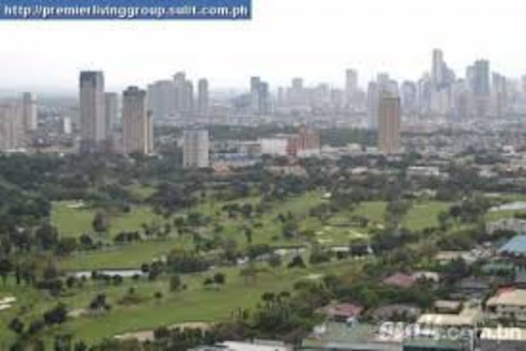 the view from the room Makati Skyline and Wack Wack Golf course