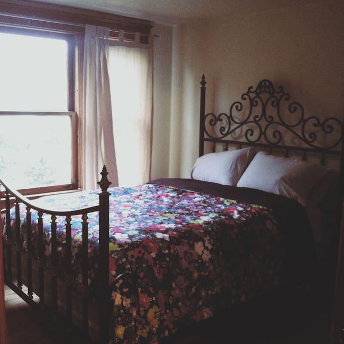 The first room, with a full sized bed.