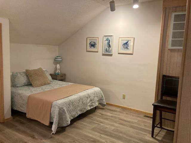 Queen bedroom loft overlooks the living area.