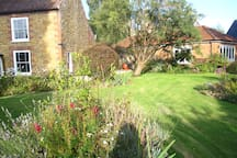 Looking back from the garden at the main house and separate studio.