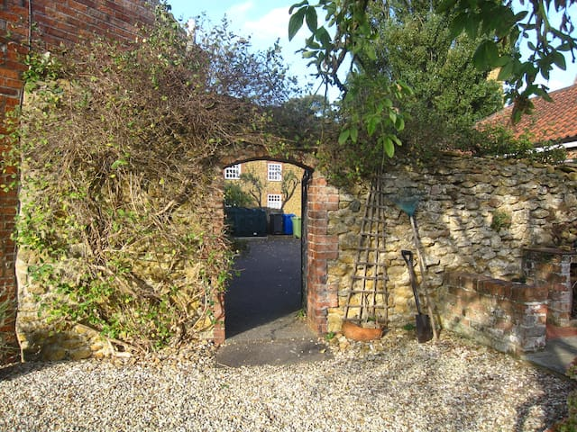 Gateway to the garden and access to the private studio.