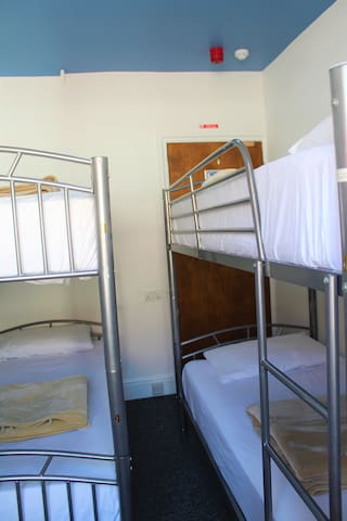 4 bed female dorm with shared shower and toilet