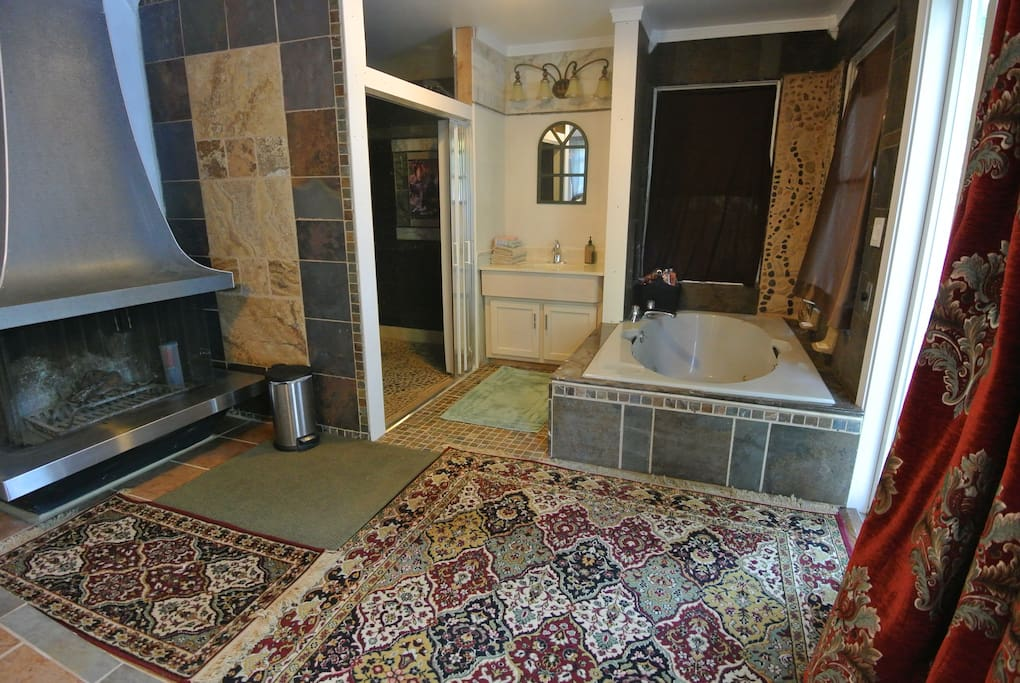 Spa room w/ toilet, sink, marble shower, jacuzzi, fire place, double bed, +table