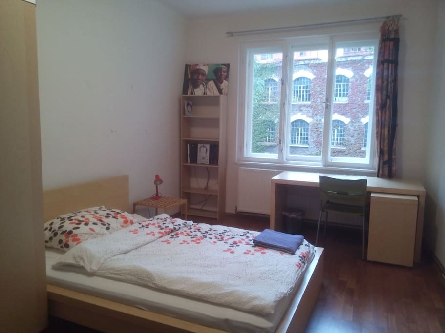one room with one double bed, and a writing desk