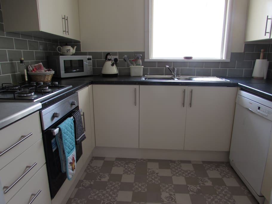 Fully fitted kitchen with all silverware, crockery, bake and cookware. Appliances include dishwasher, washer/dryer, fridge freezer and microwave.