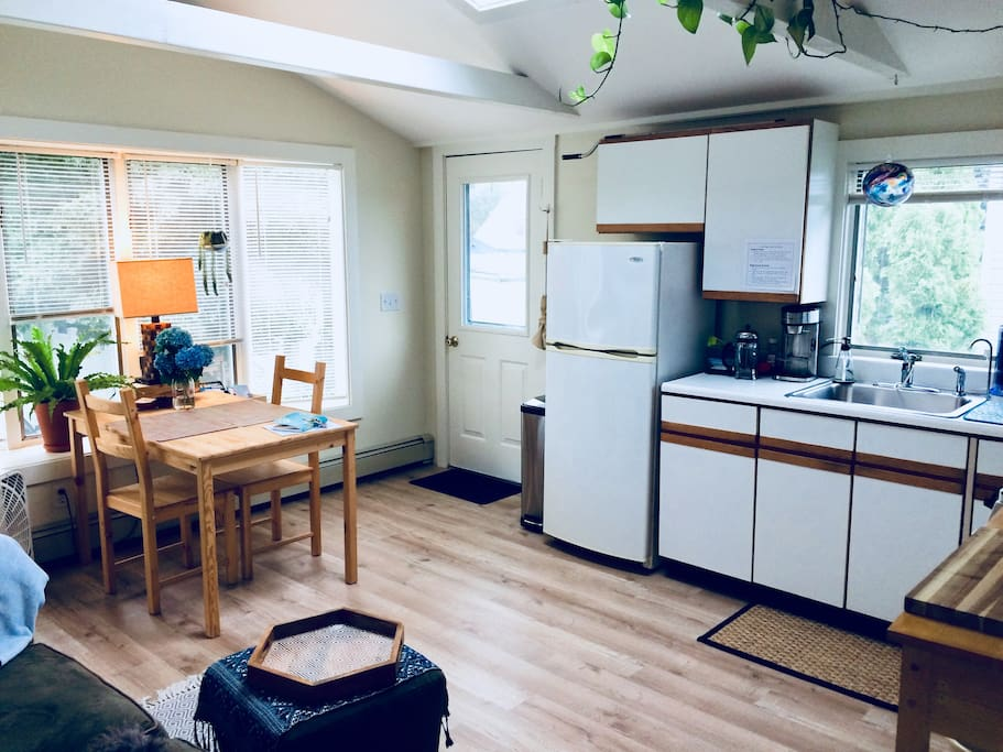 From the front door, enter into a sunny oasis, simply decorated, comfortable and outfitted with basic snacks, coffee and tee.  A comfortable table looks out over the garden—a perfect place to enjoy a meal or to get plenty of work done.