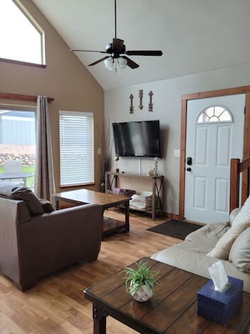 Living room area right as you entertain cottage, with a pull out sofa couch for extra sleeping space! TV equipped with roku.