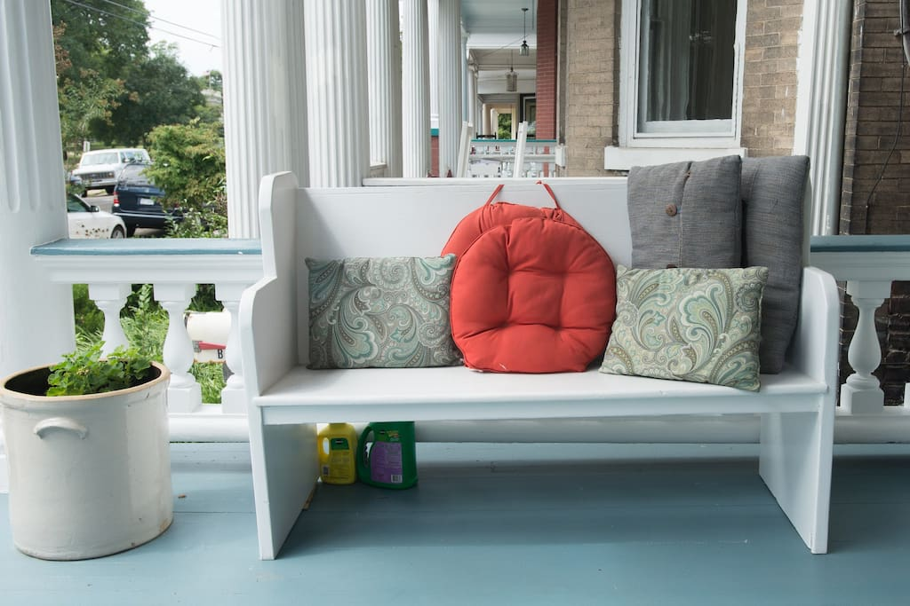 Relax on the front porch and enjoy the view of the park